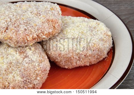 The raw patties made from minced meat before frying. Patties.