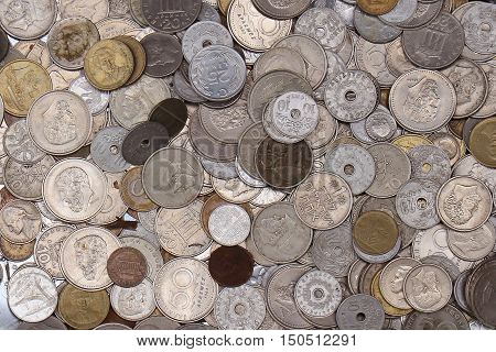 Large pile of old expired currency coins sold on flea market