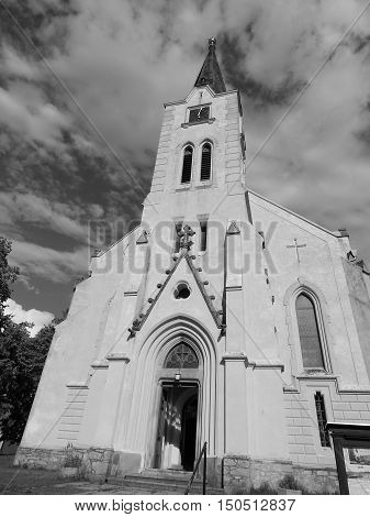 Black and white church with clouds in the backgroud