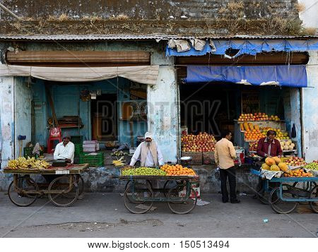 JUNAGADH GUJARAT INDIA - JANUARY 17: Hindus selling vegetables from carts in the street in the Junagadh city in the Gujarat state in India Junagadh in January 17 2015