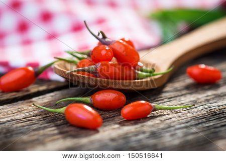Fresh Goji Berries On Wooden Background