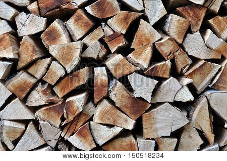 Natural Wooden Background, Chopped Firewood. Firewood Stacked And Prepared For Winter