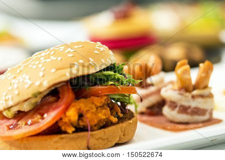 beef berger and fried potato on wood fast food junk food