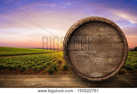 Red wine with barrel on vineyard in green Tuscany, Italy,