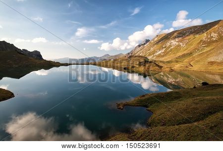 alpine lake with reflected blue sky Alps Germany