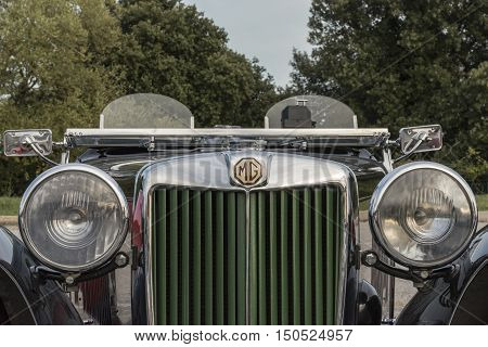 Italy,Macerata -01-october-2016: free competition and exhibition of vintage cars, take part in the competition cars of every age and cylinder capacity, both Italian and ester , this image represents a MG, old english convertible car, view of the front