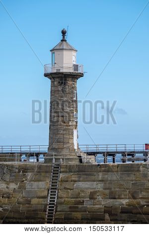 Lighthouse at harbour entrance, Whitby, Yorkshire, UK