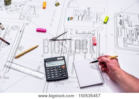 technical drawing and tools in man hand