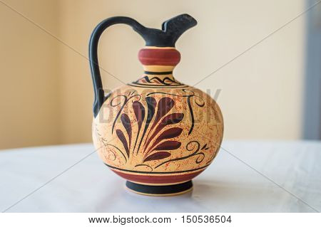 interesting pattern on empty clay pot on white table
