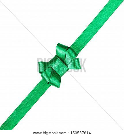 Green satin ribbon tied in a bow isolated on white background. Christmas packaging and decoration for holiday gift or present.