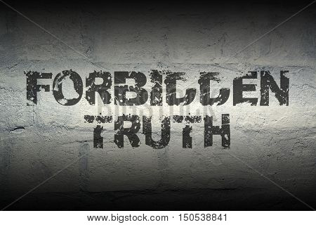 forbidden truth stencil print on the grunge white brick wall