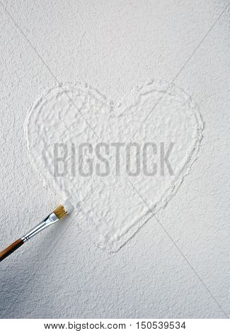 Heart on white structural plaster, copy space