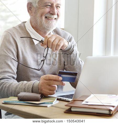 Senior Adult Holding Credit Card Concept