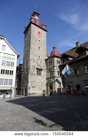 LUCERNE SWITZERLAND - MAY 08 2016: Clock tower that is a part of Town Hall that was built in early 1600's. The Clock Tower with its height over 40 meters is made of stone