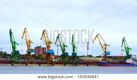 Tanker ship and working crane in Klaipeda port in Lithuania.