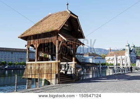 LUCERNE SWITZERLAND - MAY 05 2016: Entry to roofed wooden the Chapel Bridge that connects the two banks of the river Reuss and it is one of the Lucerne's most famous tourists attraction