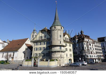 LUCERNE SWITZERLAND - MAY 5 2016: Haus zur Gilgen one of the oldest stone houses in the city and it is located on the right bank of the river Reuss.