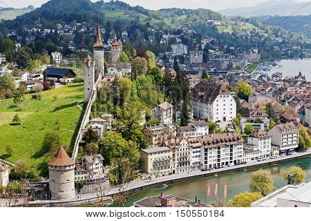 LUCERNE SWITZERLAND - MAY 04 2016: Towers of Lucerne's ancient city walls that are historic fortifications of the city are called Musegg and are mostly very well preserved