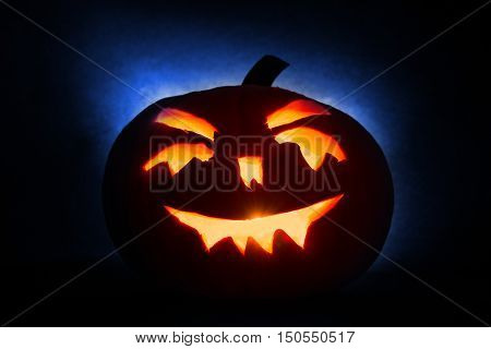 Halloween Pumpkin Head Jack Lantern With Burning Candles On Blue  Background