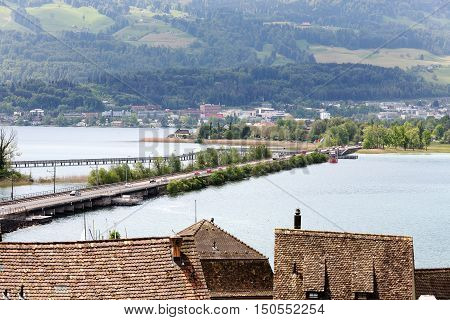 RAPPERSWIL SWITZERLAND - MAY 10 2016: Seedamm is combination of the partially artificial causeway and bridge. It is located in most narrow area of Lake Zurich and connects Rapperswil to Freienbach.