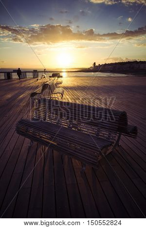 Benches on the new Hastings pier at sunset