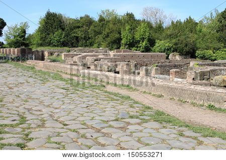 Old roman stony street at Ostia Antica the old harbour of Rome Italy