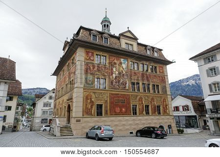 SCHWYZ SWITZERLAND - MAY 09 2016: The Town Hall of Schwyz was built in the 17th century. Its wall paintings was done to celebrate 600 years Swiss Confederation and it dates from the 19th century