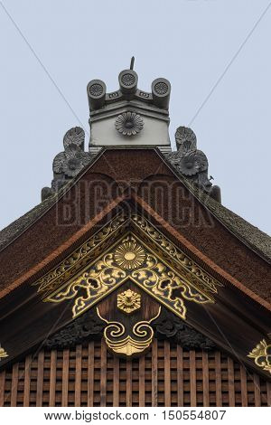 Kyoto Japan - September 14 2016: Highly decorated part of the roof shows the ridge the siding and the gable. Wood carvings special tiles and golden artwork.