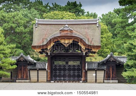 Kyoto Japan - September 14 2016: Closeup of the Kenshun-mon Gate closing the Imperial Palace grounds of from the larger park.