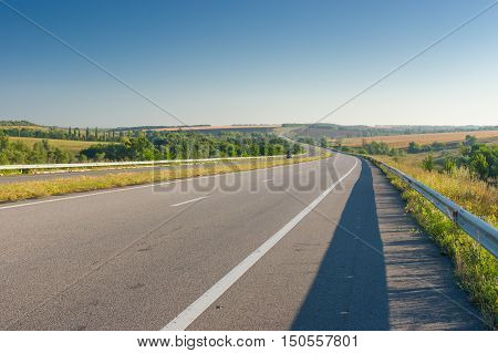 Morning landscape with high-way in central Ukraine