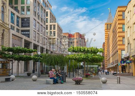 DNEPR UKRAINE - AUGUST 24, 2016:Summer landscape on European square with few people having rest on a bench at Independence Day Holiday in Dnepr city at August 24 2016