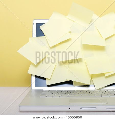 Yellow notes on a laptop screen