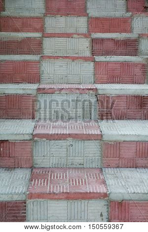 the stairs are lined with staggered concrete patterned plates.