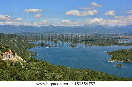Slansko Jezero lake in Montenegro. Montenegro's second city Niksic can be seen in the distance.