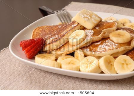 Banana Pancakes With Maple Syrup And A Fork