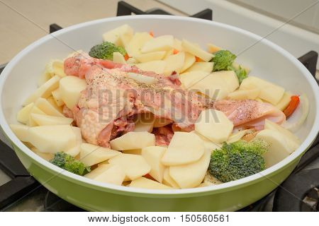 roast chicken with potatoes and broccoli before cooking