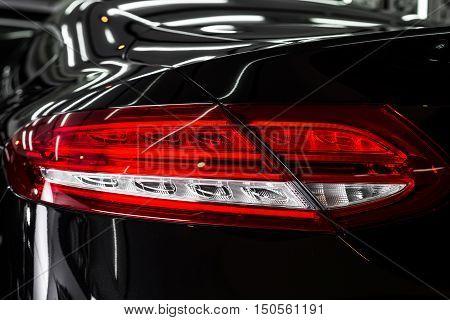 Car detailing series : Closeup of clean black car taillights