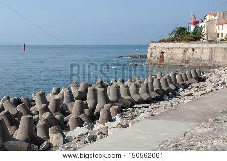 Concrete blocks tetrapod breakwater protect Ajaccio harbor, French island of Corsica