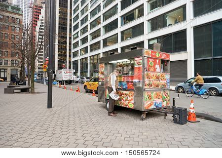 NEW YORK - CIRCA MARCH, 2016: street food in New York City. Street food is ready-to-eat food or drink sold by a hawker, or vendor, in a street or other public place, such as at a market or fair.