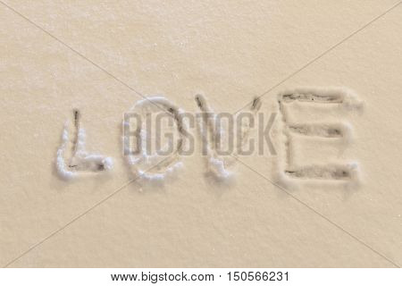 Writing text LOVE on the snow .