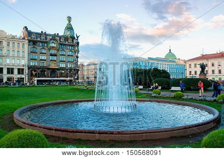 ST PETERSBURG RUSSIA - OCTOBER 3 2016. Architecture of St Petersburg -Zinger House on Nevsky Prospect in the historic center of the city and fountain on the foreground. St Petersburg center Russia