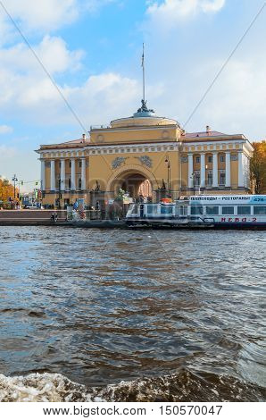 ST PETERSBURG RUSSIA-OCTOBER 3 2016. Admiralty arch on the quay of Neva river in St PetersburgRussia. Architecture landmark of St Petersburg in autumn sunny weather
