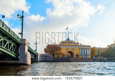ST PETERSBURG RUSSIA-OCTOBER 3 2016. Admiralty arch on the quay of Neva river and Palace bridge in St PetersburgRussia. Architecture ensemble of St Petersburg landmarks in autumn weather