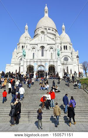 PARIS, FRANCE - March 4 ,2011: People in front of Sacre Coeur Basilica on Montmartre