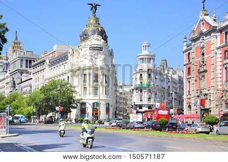 MADRID, SPAIN - September 01, 2016: Road traffic near Metropolis building on the corner of Calle de Alcala and Gran Via in Madrid