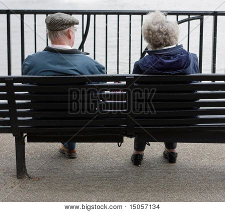 A senior couple sitting on a bench