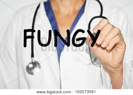 Doctor writing word Fungy with marker, Medical concept