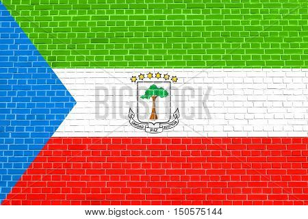 Equatorial Guinean national official flag. African patriotic symbol banner element background. Correct size colors. Flag of Equatorial Guinea on brick wall texture background, 3d illustration