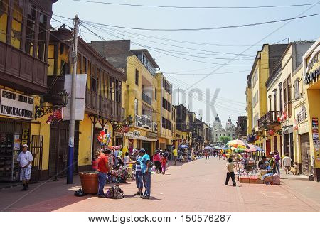 Lima, Peru -December 31, 2013: Street view of Lima old town with traditional colorful houses and wooden balcony.