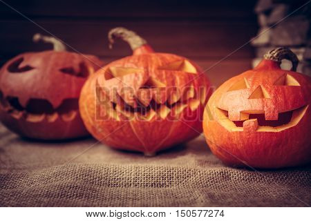 Halloween pumpkins family still life on rustic background